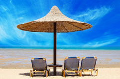 Tropical beach. With empty loungers Stock Photo