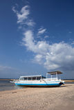 Tropical beach. Boat on a tropical beach of the Gili Air Island in Indonesia, Asia Stock Photography