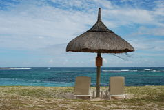 Tropical beach. With umbrella in Mauritius royalty free stock image