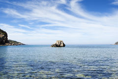 Tropical beach. Rock in a sandy beach with turquoise water in spain Royalty Free Stock Photography