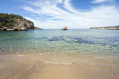 Tropical beach. Rock in a sandy beach with turquoise water in spain Royalty Free Stock Photo