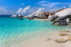 Tropical beach. Beach with rocks, blue sky, and turquoise green water Royalty Free Stock Photography