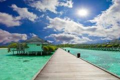 Tropical beach. A tropical beach with dock Stock Photo