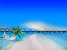 Tropical Beach. With Bungalows and blue sky Stock Image
