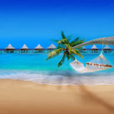 Tropical Beach. With Bungalows and blue sky Royalty Free Stock Image