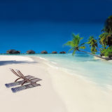 Tropical Beach. With pair of Chairs and blue sky Royalty Free Stock Images