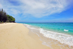 Tropical beach. The white sand beach on a tropical island Royalty Free Stock Photo