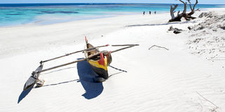 Tropical beach. In Madagascar. White sand and traditional boat Royalty Free Stock Photo