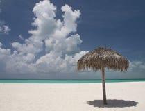 Tropical beach. Umbrella alone on a beautiful tropical beach Royalty Free Stock Photography