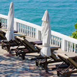 Tropical beach. Chaise lounges by the sea in Thailand Stock Photo