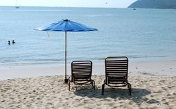 Tropical Beach. Beautiful Cenang Beach in Langkawi, Malaysia,  two beach benches by sea Royalty Free Stock Photography