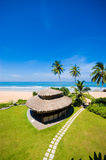 Tropical beach. Bungalow on the tropical beach stock photo