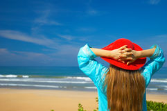 Tropical beach. Woman in red hat on the tropical beach Royalty Free Stock Images