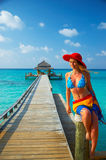 Tropical beach. Woman in red hat on the tropical beach Royalty Free Stock Photography