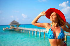 Tropical beach. Woman in red hat on the tropical beach Stock Photo