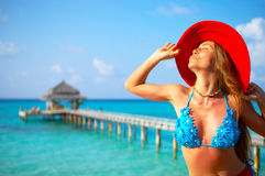 Tropical beach. Woman in red hat on the tropical beach stock photos