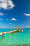 Tropical beach. Jetty on the tropical beach Royalty Free Stock Photography