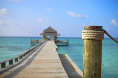 Tropical beach. Jetty on the tropical beach Stock Photo