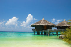 Tropical beach. Water bungalows on the tropical beach Royalty Free Stock Image