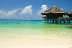 Tropical beach. Water bungalow on the tropical beach Stock Photo