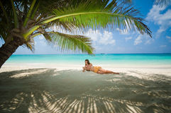 Tropical beach. Woman on the tropical beach royalty free stock photography