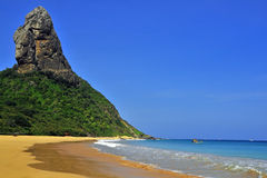 Tropical beach. Empty and tropical beach with huge rock moutain Stock Image
