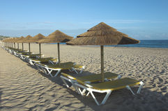 Tropical beach. Beach umbrellas and chairs Stock Photography