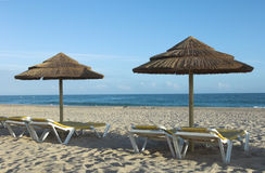 Tropical beach. Empty beach with umbrellas and chairs Stock Photo