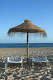 Tropical beach. Empty beach with umbrella and chair Royalty Free Stock Photos