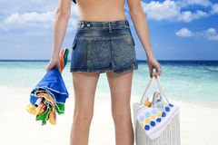 Tropical beach. Rear view of woman on tropical beach. Copy space Stock Images