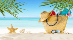 Tropical beach with accessories on sand, summer holiday backgrou Royalty Free Stock Photos