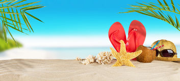 Tropical beach with accessories on sand, summer holiday backgrou Stock Photos