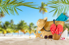Tropical beach with accessories on sand, summer holiday backgrou. Tropical beach with sunbathing accessories, summer holiday background. Travel and beach Stock Photo