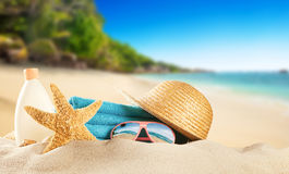 Tropical beach with accessories, summer holiday background. Royalty Free Stock Photos