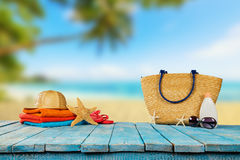 Tropical beach with accessories on wooden planks, summer holiday Stock Images