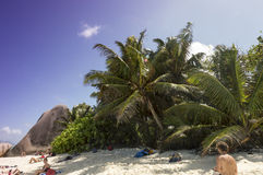 Tropical beach Anse Source D'Argent at La Digue Island, Seychelles - vacation background. La Digue, Seychelles - August 12, 2015: Paradise beach of Seychelles in Royalty Free Stock Images