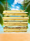 Tropical beach background with exotic wood board sign. Room for text or copy space Royalty Free Stock Photo