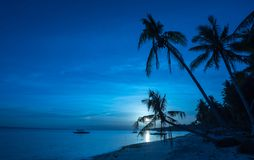Tropical beach background of night view from Dumaluan Beach royalty free stock image