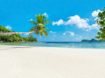 Tropical beach Baie Lazare with boat, Mahe island, Seychelles Stock Photo