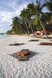 Tropical beach bar boracay island philippines. Native style cushions and tables on the white sand beach of boracay island in the philippines Stock Image