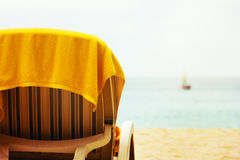 Tropical beach with beach chair Royalty Free Stock Images