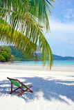 Tropical beach. Beach chairs on the white sand beach Stock Photo