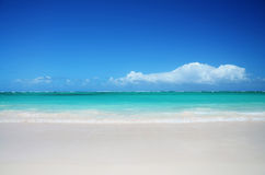 Tropical beach and beautiful clouds Stock Photos
