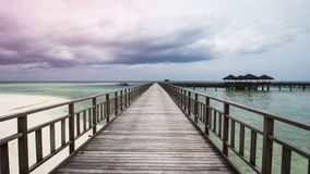 Wooden Beach Dock or Wooden Pier at Beautiful Tropical Beach. Tropical Beach is Beautiful Exotic Travel Destination in The World Stock Images