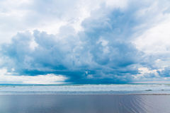 Tropical beach and beautiful sea. Blue sky with clouds in the ba Stock Images