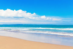 Tropical beach and beautiful sea. Blue sky with clouds in the ba royalty free stock image