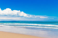 Tropical beach and beautiful sea. Blue sky with clouds in the ba Royalty Free Stock Photos