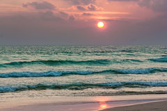 Tropical beach at beautiful sunrise. Stock Photo