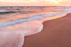 Tropical beach at beautiful sunset. Stock Photos