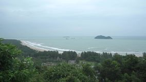 Tropical beach behind jungle in bad weather. Slow motion video. Clip stock footage